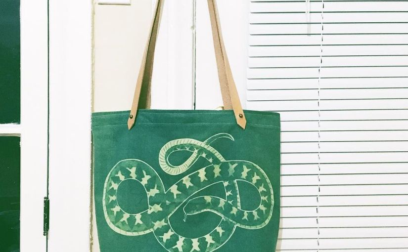 wrapping up one final piece before my trunk show tomorrow- a canvas snake print tote
